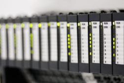 60301249 - programmable logic controllers installed in a control panel. selective focus.